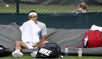 Roger Federer of Switzerland  attends  training session at the All England Lawn Tennis Championships in Wimbledon, London, Saturday, July 1, 2017.  (Peter Klaunzer/Keystone via AP)