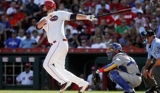 Cincinnati Reds' Jackson Stephens, left, hits a go-ahead two-run single off Chicago Cubs starting pitcher Eddie Butler in the fourth inning of a baseball game, Saturday, July 1, 2017, in Cincinnati. (AP Photo/John Minchillo)