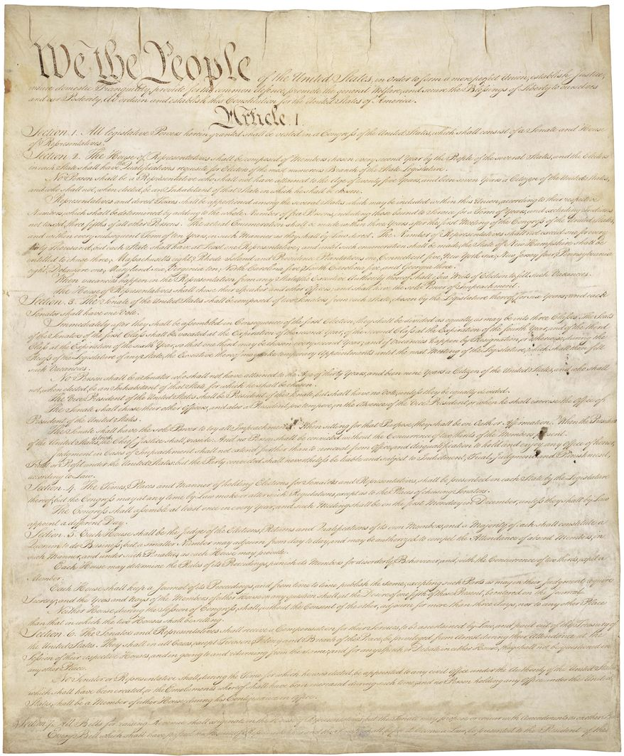 This photo made available by the U.S. National Archives shows the first page of the United States Constitution. (National Archives via AP)