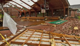 In this May 24, 2017 photo, the roof was blown off gymnasium at Courtney Elementary School and the end walls were blown in by a tornado that passed through the area in Courtney, N.C. Beyond an architectural treasure, the gym was something of a community hub for Courtney, a place that was open to locals outside of school hours for birthday parties and recreation-league sports. (Walt Unks/The Winston-Salem Journal via AP)