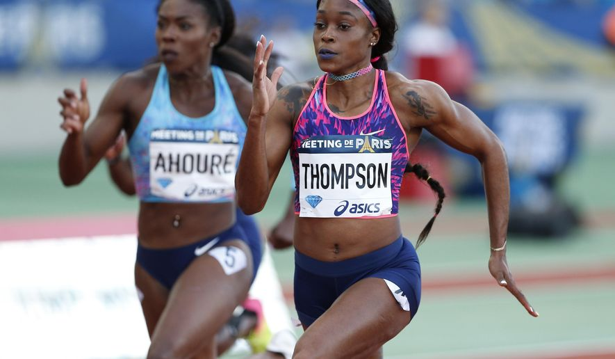 Jamaica's Elaine Thompson, right, competes during a women's 100m race at the IAAF Diamond League athletics meeting at Charlety Stadium, in Paris, France, Saturday July 1, 2017. (AP Photo/Thibault Camus)