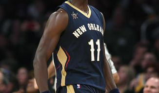 FILE - In this March 5, 2017 file photo, New Orleans Pelicans guard Jrue Holiday celebrates after scoring during the second half of an NBA basketball game against the Los Angeles Lakers. Point guards are cashing in so far in NBA free agency, teams have already paid nearly a half-billion dollars in commitments to five and Day 1 is still a long way from complete. Holiday is among the early cashers-in and has agreed to terms on a new five-year, $126 million deal with the New Orleans Pelicans.  (AP Photo/Mark J. Terrill, File)