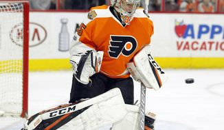 FILE - In this April 8, 2017, file photo, Philadelphia Flyers' Steve Mason tracks the incoming puck during the team's NHL hockey game against the Columbus Blue Jackets  in Philadelphia. There were only a handful of openings for starters or in platoon situations, making the free agency process plenty stressful for him and his goaltending counterparts around the NHL. Even in this climate, the goaltending market was robust on the first day of free agency as Briant Elliott signed a two-year deal with Philadelphia, Mason with Winnipeg and Ryan Miller with Anaheim. (AP Photo/Tom Mihalek, File)