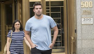 Billy McFarland, right, leaves federal court with his attorney Sabrina Shroff after his arraignment, Saturday, July 1, 2017, in New York. McFarland is charged with scheming to defraud investors in his company, Fyre Media. McFarland's Fyre Festival was billed as an ultra-luxurious event with headliners including rockers Blink-182 and the hip-hop act Migos, but the show was canceled after performers bowed out. (AP Photo/Mary Altaffer)
