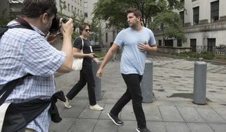Billy McFarland, right, is followed by reporters as he leaves federal court after his arraignment, Saturday, July 1, 2017, in New York. McFarland is charged with scheming to defraud investors in his company, Fyre Media. McFarland's Fyre Festival was billed as an ultra-luxurious event with headliners including rockers Blink-182 and the hip-hop act Migos, but the show was canceled after performers bowed out. (AP Photo/Mary Altaffer)