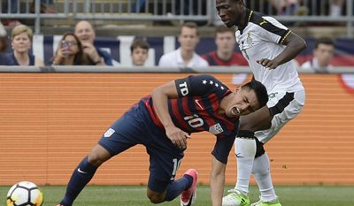 United States' Joe Corona, left, is pressured by Ghana's Ebenezer Ofori, right, during the first half of an international friendly soccer match at Pratt & Whitney Stadium at Rentschler Field, Saturday, July 1, 2017, in East Hartford, Conn. (AP Photo/Jessica Hill)