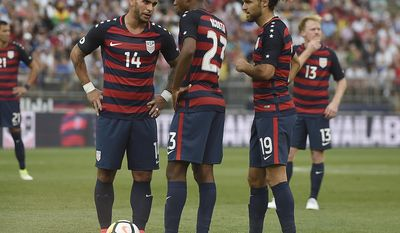 United States' Dom Dwyer, left, talks with teammates Kellyn Acosta, center, and Graham Zusi, right, during the second half of an international friendly soccer match against Ghana, Saturday, July 1, 2017, in East Hartford, Conn. (AP Photo/Jessica Hill)