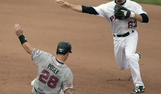 Pittsburgh Pirates' Max Moroff (62) throws to first after forcing San Francisco Giants' Buster Posey (28) out at second base in the seventh inning of a baseball game in Pittsburgh, Saturday, July 1, 2017. (AP Photo/Fred Vuich)