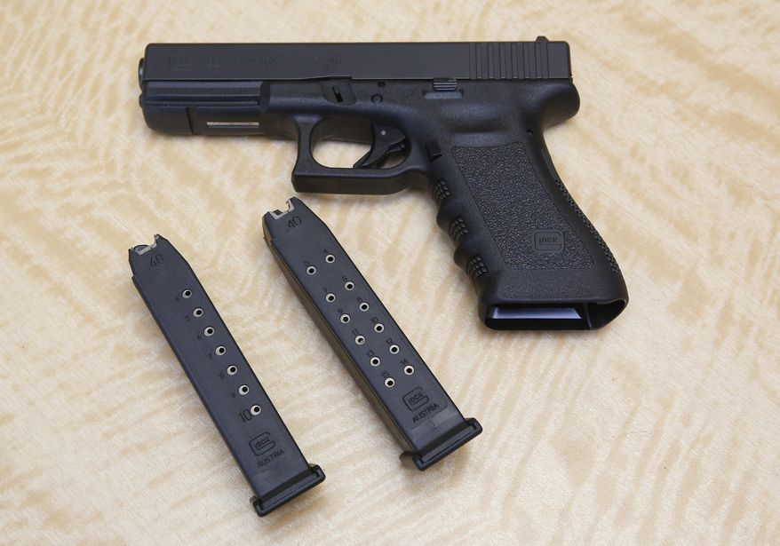 In this Tuesday, June 27, 2017 photo, a semi-automatic hand gun is displayed with a 10-round magazine, left, and a 15-round magazine, right, at a gun store in Elk Grove, Calif. A group of gun-rights activists on March 10, 2020, filed a lawsuit against the state of Connecticut over a law that bans civilians from using a magazine that holds more than 10 rounds. (AP Photo/Rich Pedroncelli) **FILE**