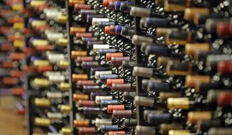 FILE - In this June 16, 2016, file photo, bottles of wine are displayed during a tour of a state liquor store, in Salt Lake City.  (AP Photo/Rick Bowmer, File)