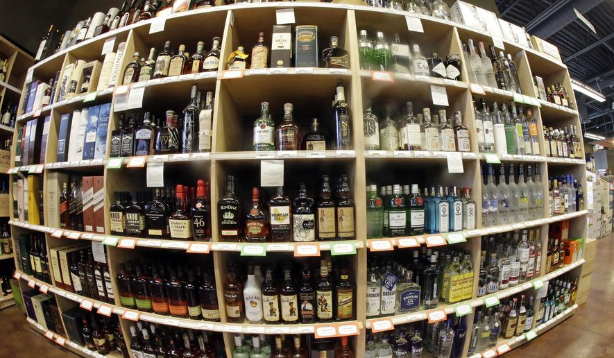 FILE - This June 16, 2016, file photo, taken with a fisheye lens, shows bottles of alcohol during a tour of a state liquor store, in Salt Lake City. Higher liquor prices and other changes under a broad new Utah liquor law will take effect Saturday, July 1, 2017, along with a highway funding bill and a test program allowing people convicted of drunken driving to avoid having their driver's license suspended. (AP Photo/Rick Bowmer, File)