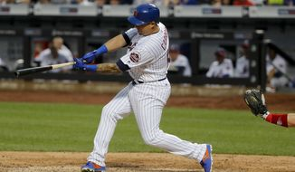 New York Mets' Asdrubal Cabrera (13) connects for a two-run home run against the Philadelphia Phillies during the seventh inning of a baseball game, Saturday, July 1, 2017, in New York. (AP Photo/Julie Jacobson)