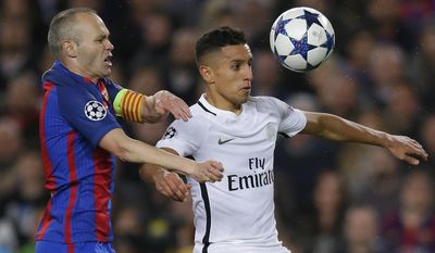 FILE- In this Wednesday March 8, 2017 file photo, PSG's Marquinhos is challenged by Barcelona's Andres Iniesta, left, during the Champion's League round of 16, second leg soccer match between FC Barcelona and Paris Saint Germain at the Camp Nou stadium in Barcelona, Spain. Brazilian center half Marquinhos has signed a new three-year deal with Paris Saint-Germain, Saturday, July 1, 2017, tying him to the club until 2022. (AP Photo/Manu Fernandez, File)