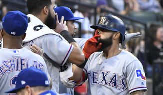 Texas Rangers' Rougned Odor, right, celebrates with teammates after his two-run home run against the Chicago White Sox during the fourth inning of a baseball game in Chicago on Friday, June 30, 2017. (AP Photo/Matt Marton)