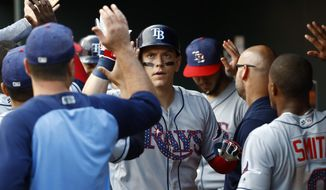 Tampa Bay Rays' Logan Morrison high-fives teammates in the dugout after hitting a two-run home run in the first inning of a baseball game against the Baltimore Orioles in Baltimore, Saturday, July 1, 2017. (AP Photo/Patrick Semansky)