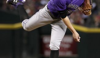 Colorado Rockies starting pitcher Jon Gray throws against the Arizona Diamondbacks during the third inning of a baseball game, Friday, June 30, 2017, in Phoenix. (AP Photo/Matt York)