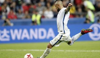 Chile's Arturo Vidal scores a penalty during a shootout at the end of the Confederations Cup, semifinal soccer match between Portugal and Chile, at the Kazan Arena, Russia, Wednesday, June 28, 2017. (AP Photo/Pavel Golovkin)