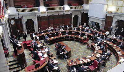 Members of the New York state Senate appear on the floor of the Senate chamber during a special legislative session at the Capitol on Wednesday, June 28, 2017, in Albany, N.Y. (AP Photo/Hans Pennink)