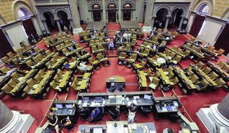 Members of the New York state Assembly stand in the Assembly Chamber during a special legislative session at the Capitol on Wednesday, June 28, 2017, in Albany, N.Y. (AP Photo/Hans Pennink)