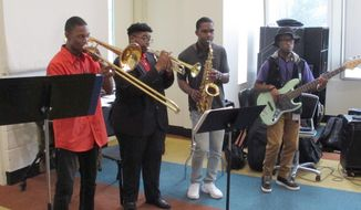 A group of Stax Music Academy musicians rehearse for their upcoming tour of Europe on Friday, June 30, 2017 in Memphis, Tenn. Fifty years after the Stax Records tour, a group of young musicians educated at Stax Music Academy are again bringing the music of Memphis back to Europe. (AP Photo/Adrian Sainz)