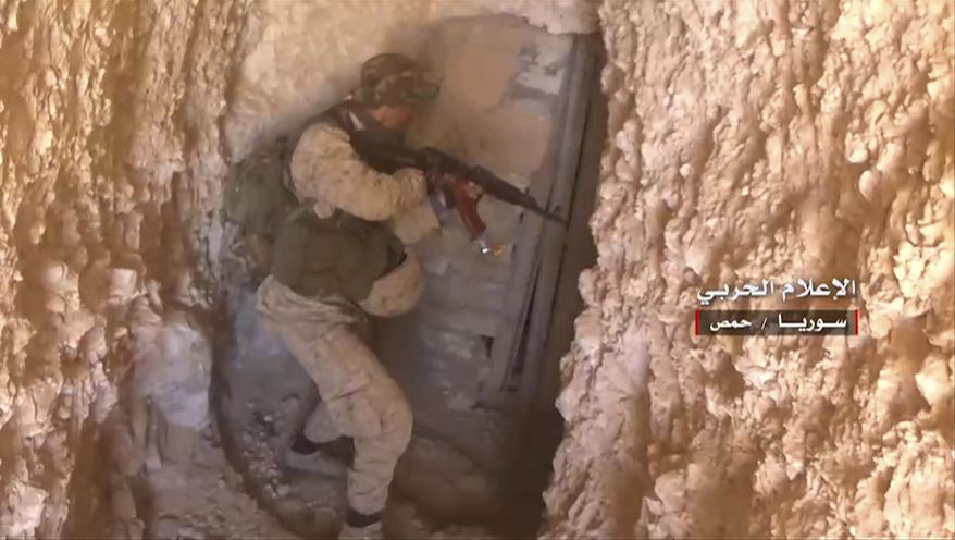 "This frame grab from video released on May 26, 2017 and provided by the government-controlled Syrian Central Military Media, shows a Syrian army soldier inspects a tunnel used by Islamic states, in Homs provence, Syria. Arabic reads, ""Central Military Media, Homs, Syria."" (Syrian Central Military Media, via AP)"