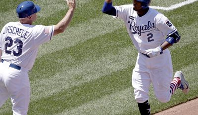 Kansas City Royals' Alcides Escobar (2) celebrates with third base coach Mike Jirschele after hitting a two-run home run during the fourth inning of the first baseball game of a doubleheader against the Minnesota Twins, Saturday, July 1, 2017, in Kansas City, Mo. (AP Photo/Charlie Riedel)