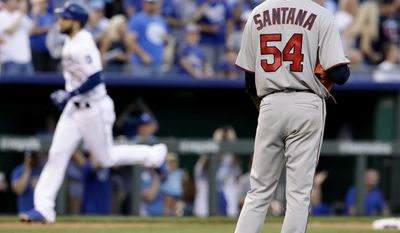 Kansas City Royals' Eric Hosmer, left, runs the bases past Minnesota Twins starting pitcher Ervin Santana after hitting a three-run home run during the fourth inning of a baseball game Friday, June 30, 2017, in Kansas City, Mo. (AP Photo/Charlie Riedel)
