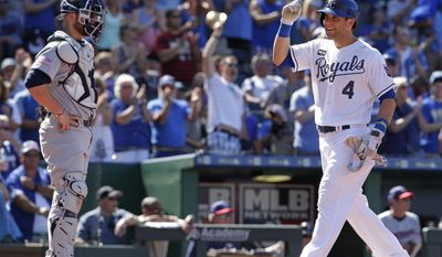 Kansas City Royals' Alex Gordon crosses the plate in front of Minnesota Twins catcher Chris Gimenez after hitting a three-run home run during the eighth inning of the first baseball game of a doubleheader Saturday, July 1, 2017, in Kansas City, Mo. (AP Photo/Charlie Riedel)