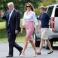 President Trump, first lady Melania Trump, and son Barron on the South Lawn of the White House as the Fourth of July long holiday weekend got underway. (Associated Press)