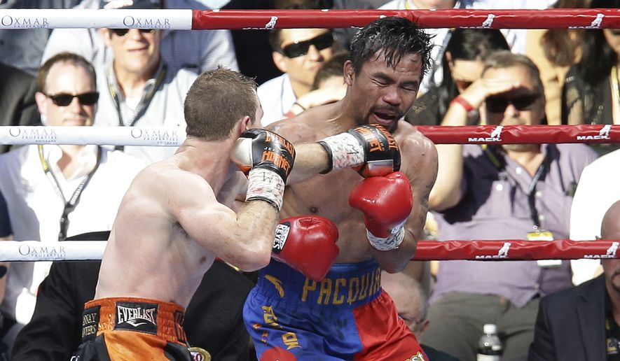 Manny Pacquiao, right, of the Philippines and Jeff Horn of Australia fight during their WBO World welterweight title bout in Brisbane, Australia, Sunday, July 2, 2017. Pacquiao lost his WBO welterweight world title to Horn in a stunning, unanimous points decision in the Sunday afternoon bout billed as the Battle of Brisbane in front of more than 50,000 people. (AP Photo/Tertius Pickard)