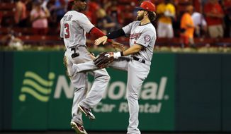 Washington Nationals' Bryce Harper, right, and teammate Michael Taylor celebrate following a baseball game against the St. Louis Cardinals Sunday, July 2, 2017, in St. Louis. The Nationals won 7-2. (AP Photo/Jeff Roberson)