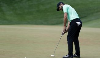 Kyle Stanley sinks the winning putt on the 18th green of the playoff, during the Quicken Loans National golf tournament, Sunday, July 2, 2017, in Potomac, Md. (AP Photo/Alex Brandon)