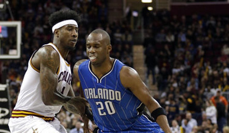 "FILE - In this April 4, 2017, file photo, Orlando Magic's Jodie Meeks (20) drives past Cleveland Cavaliers' Iman Shumpert (4) in the second half of an NBA basketball game in Cleveland. The agency that represents Meeks says the free-agent shooting guard has agreed to join the Washington Wizards. ASM Sports sent out a tweet on Sunday, July 2, 2017, saying Meeks ""has committed to signing"" with the Wizards. (AP Photo/Tony Dejak, File)"
