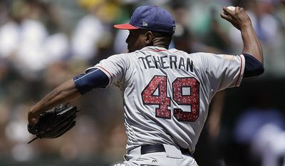 Atlanta Braves pitcher Julio Teheran works against the Oakland Athletics in the first inning of a baseball game Sunday, July 2, 2017, in Oakland, Calif. (AP Photo/Ben Margot)