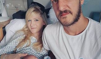 This is an undated hand out photo of Chris Gard and Connie Yates with their son Charlie Gard provided by the family, at Great Ormond Street Hospital, in London. The parents of terminally-ill baby boy Charlie Gard lost the final stage of their legal battle on Tuesday, June27, 2017 to take him out of a British hospital to receive treatment in the U.S., after a European court agreed with previous rulings that the baby should be taken off life support. (Family of Charlie Gard via AP)