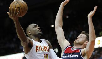 In this April 28, 2017, photo, Atlanta Hawks forward Paul Millsap (4) shoots against Washington Wizards forward Jason Smith (14) in the first half of an NBA playoff basketball game in Atlanta. A person with knowledge of the situation told The Associated Press on Sunday, July 2, that Paul Millsap has agreed to terms with the Denver Nuggets on a three-year deal worth $90 million. The person spoke on condition of anonymity because the contract cannot be signed until Thursday. (AP Photo/John Bazemore)