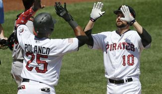 Pittsburgh Pirates' Jordy Mercer (10) is greeted by Gregory Polanco (25) after driving him in with a two-run home run in the fourth inning of a baseball game against the San Francisco Giants, Sunday, July 2, 2017, in Pittsburgh. (AP Photo/Keith Srakocic)