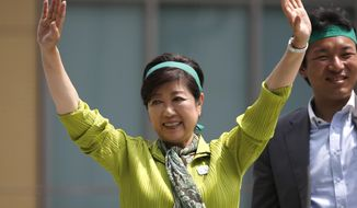 """In this Thursday, June 29, 2017 photo, Tokyo Gov. Yuriko Koike waves to a crowd during her """"Tomin (Tokyoites) First"""" party's campaign rally for Tokyo Metropolitan Assembly election in Tokyo. Tokyo residents were voting for the city's assembly in an election Sunday, July 2,  2017, that could alter national politics as the populist governor Koike aims to strengthen her base and challenge Prime Minister Shinzo Abe's scandal-laden ruling party.   (AP Photo/Shuji Kajiyama)"""
