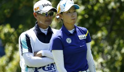 Ji Yeon Choi, left, father and caddie for Chella Choi, of South Korea, talks to his daughter on the fifth tee during the final round of the Women's PGA Championship golf tournament at Olympia Fields Country Club, Sunday, July 2, 2017, in Olympia Fields, Ill. (AP Photo/Charles Rex Arbogast)