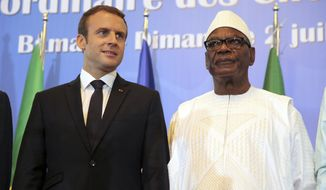 French President Emmanuel Macron, left, stands next to Malian President Ibrahim Boubacar Keita during the opening session of G5 Sahel force summit in Bamako, Mali, Sunday, July 2, 2017. Macron is meeting with heads of state from five nations across Africa's Sahel region to strengthen a new 5,000-strong regional force meant to counter a growing threat from extremists who have targeted tourist resorts and other high-profile areas. (AP Photo/Baba Ahmed)