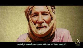 This undated frame grab from video, posted online by recently formed militant group Nusrat al-Islam wal Muslimeen, shows hostage Elliot Kenneth Arthur of Australia in an unknown location, with a caption reading in Arabic 'I'm Elliot Kenneth Arthur, I'm 82 years old, born in Australia.' An al-Qaida-linked group in Mali has released, Saturday, July 1, 2017, a proof-of-life video showing six foreign hostages, a group that monitors jihadist communications says, shortly before the French president's arrival in the West African country for an anti-terror summit. (Militant Video via AP)