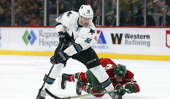 FILE - In this March 21, 2017, file photo, San Jose Sharks' Patrick Marleau (12) gains control of the puck against Minnesota Wild's Jared Spurgeon (46) in the second period of an NHL hockey game in St. Paul, Minn. Marleau has left the Sharks and signed an $18.75 million, three-year deal with the Toronto Maple Leafs.(AP Photo/Stacy Bengs)