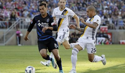 San Jose Earthquakes forward Chris Wondolowski (8) is chased by Los Angeles Galaxy defenders Dave Romney (4) and Rafael Garcia (25) during the first half of an MLS soccer match Saturday, July 1, 2017, in San Jose, Calif. (AP Photo/Marcio Jose Sanchez)