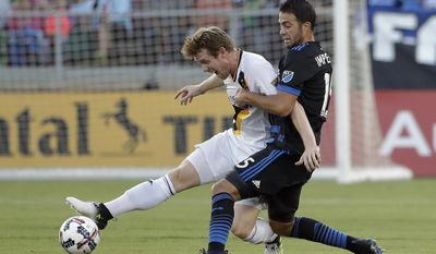 Los Angeles Galaxy's Jack McBean, left, is defended by San Jose Earthquakes' Andres Imperiale during the first half of an MLS soccer match Saturday, July 1, 2017, in San Jose, Calif. (AP Photo/Marcio Jose Sanchez)