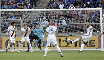 Los Angeles Galaxy defender Jelle Van Damme, right, shoots to score against the San Jose Earthquakes during the first half of an MLS soccer match Saturday, July 1, 2017, in San Jose, Calif. (AP Photo/Marcio Jose Sanchez)
