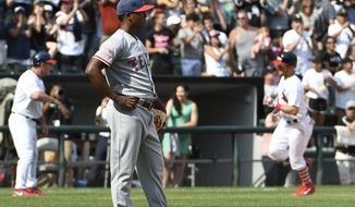 Texas Rangers relief pitcher Jose Leclerc, foreground, reacts after giving up a two-run home run to Chicago White Sox's Yolmer Sanchez during the eighth inning of a baseball game, Sunday, July 2, 2017, in Chicago. (AP Photo/David Banks)