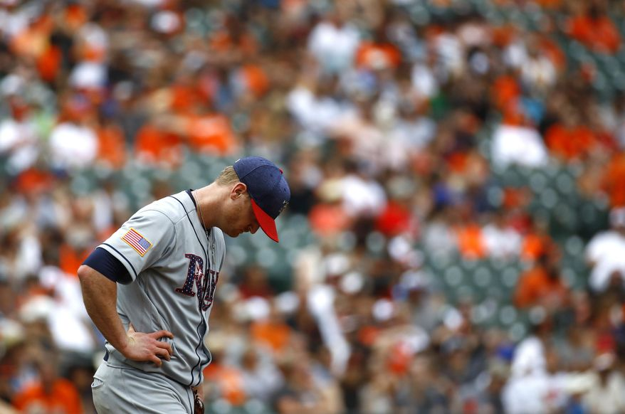 Tampa Bay Rays starting pitcher Alex Cobb pauses on the mound in the third inning of a baseball game against the Baltimore Orioles in Baltimore, Sunday, July 2, 2017. Baltimore scored four runs against Cobb in the inning. (AP Photo/Patrick Semansky)