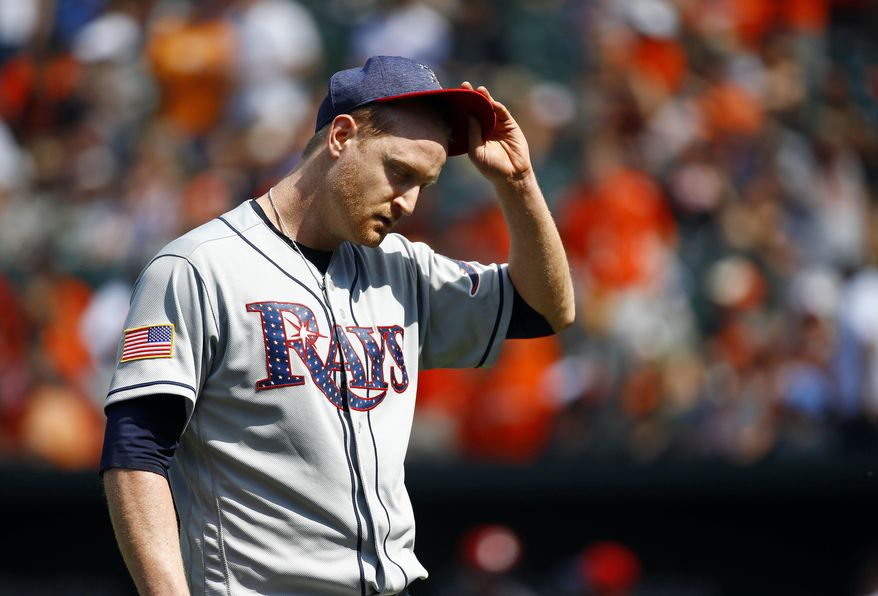 Tampa Bay Rays starting pitcher Alex Cobb walks off the field after being relieved in the seventh inning of a baseball game against the Baltimore Orioles in Baltimore, Sunday, July 2, 2017. Baltimore won 7-1. (AP Photo/Patrick Semansky)