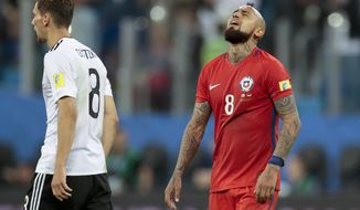 Chile's Arturo Vidal looks up at the end of the Confederations Cup final soccer match between Chile and Germany, at the St.Petersburg Stadium, Russia, Sunday July 2, 2017. Germany won 1-0. (AP Photo/Ivan Sekretarev)