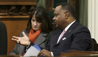 FILE - In this Jan. 24, 2017, file photo are Board of Equalization members Diane Harkey, left, and Jerome Horton at the Governor's annual State of the State address in Sacramento, Calif. The Legislature approved a proposal by Gov. Jerry Brown, Assembly Speaker Anthony Rendon, D-Paramount and Senate President Pro Tem Kevin de Leon, D-Los Angeles, to eliminate nearly all the power of the elected members of the the Board of Equalization and give it to a newly created agency overseen by the governor beginning Saturday, July 1. The change was prompted by an audit that alleged Harkey and Horton used staff for promotional duties. (AP Photo/Rich Pedroncelli, File)